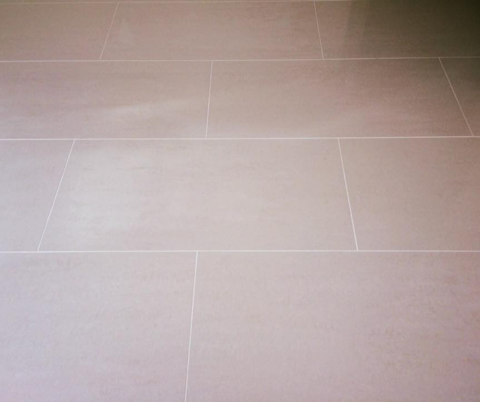 Glossy floor tiles fitted by Stone and Earth